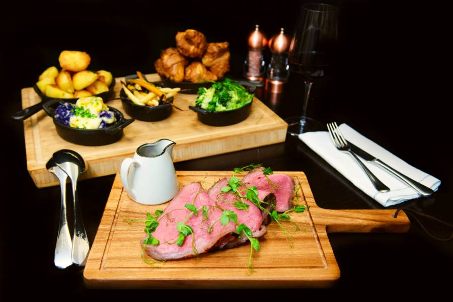 Treacle and thyme cured, roasted sirloin of Black Angus Beef on a sharing board with accompaniments